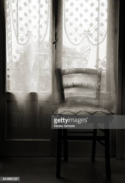 Empty chair by window