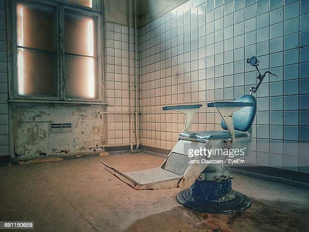 Empty Chair In Abandoned Building
