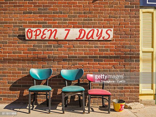 Empty chair in front of store