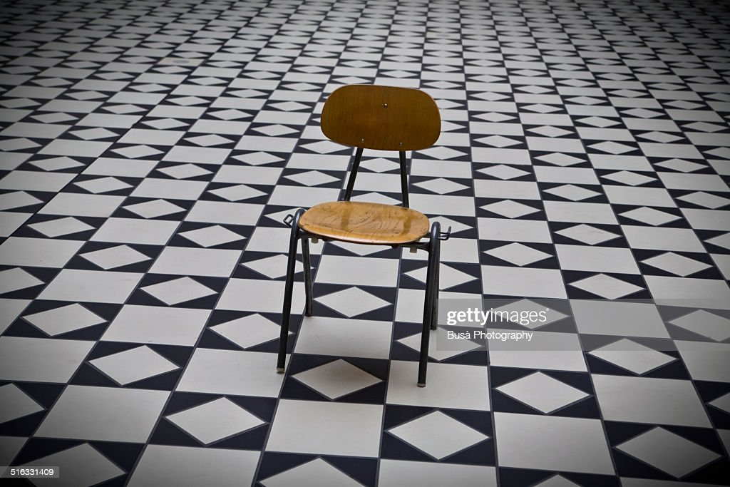 Empty Chair in the middle of a room : Stock Photo