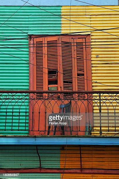Empty chair on an old balcony, dock area La Boca, Buenos Aires, Argentina, South America