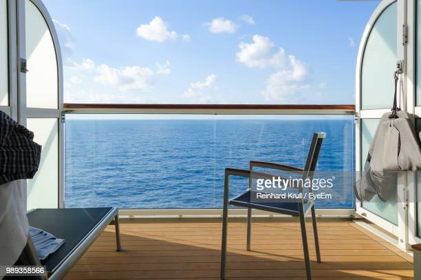 Empty Chair On Boat Deck Of Cruise Ship Against Sky