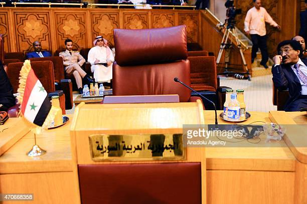 Empty chair reserved for Syria is seen during the meeting of the army chiefs from Arab League nations at the Arab League headquarters in Cairo on...