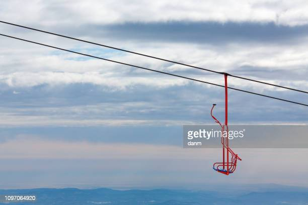 empty chairlifts in moutain - schladming stock pictures, royalty-free photos & images