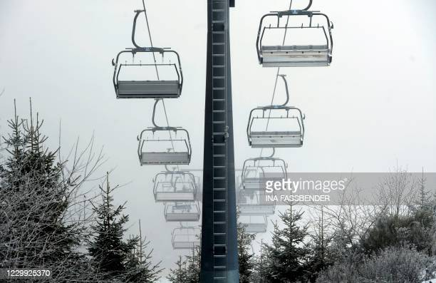 Empty chairlifts of a ski station are seen at the winter sports region of Winterberg, western Germany, on December 3, 2020. - Germany, which holds...