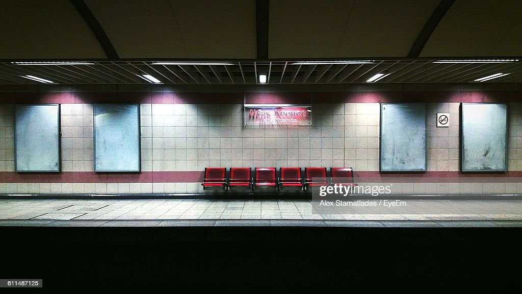 Empty Chairs Against Illuminated Wall At Subway Station : Stock Photo