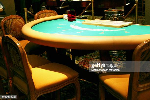 Empty chairs and 21 table at casino