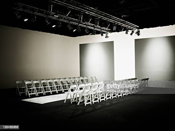 Empty chairs and catwalk set for fashion show