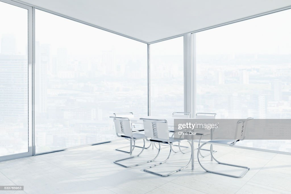 Empty chairs and conference table in office : Foto stock