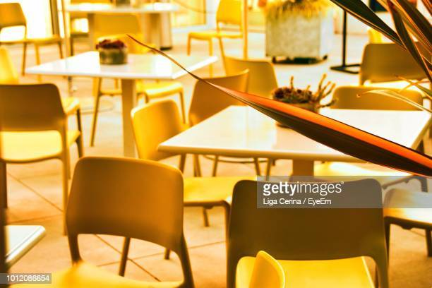 empty chairs and table in cafe - liga cerina stock pictures, royalty-free photos & images