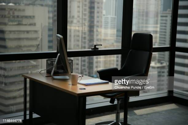 empty chairs and table in office - empty desk stock pictures, royalty-free photos & images