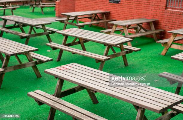 empty chairs and tables at sidewalk cafe - christian soldatke stockfoto's en -beelden