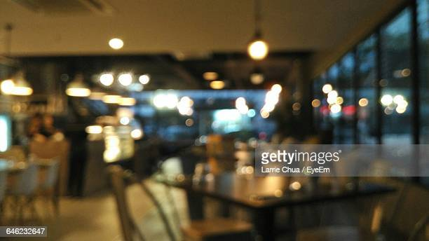 Empty Chairs And Tables In Blurred Restaurant
