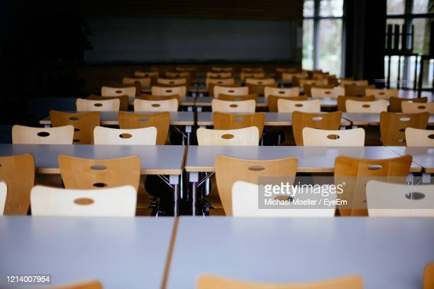 empty chairs and tables in classroom - 教育 ストックフォトと画像