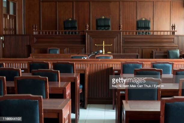 empty chairs and tables in courtroom - courtroom stock pictures, royalty-free photos & images
