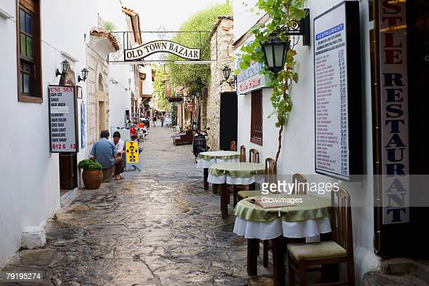 Empty chairs and tables in front of a restaurant in a street, Ephesus, Turkey