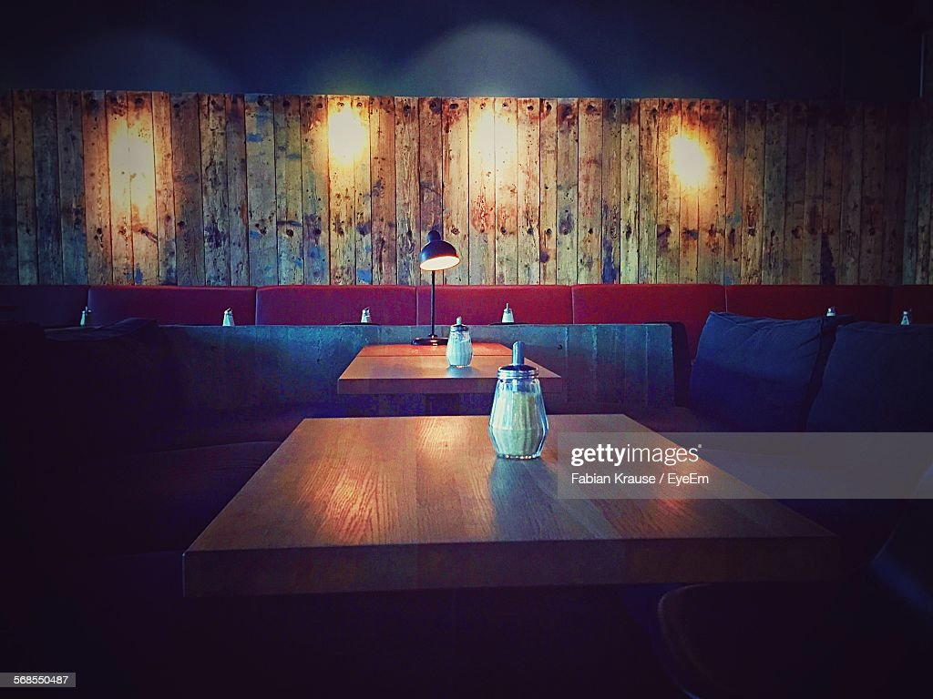 Empty Chairs And Tables In Illuminated Restaurant : Stock Photo