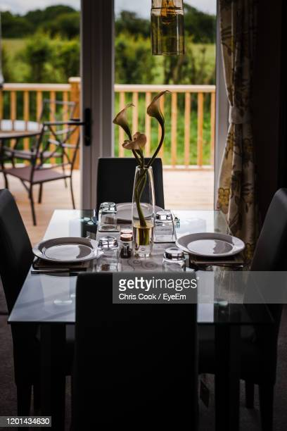 empty chairs and tables in restaurant - malton stock pictures, royalty-free photos & images
