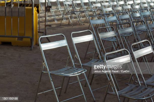 empty chairs and tables in row - sport venue stock pictures, royalty-free photos & images