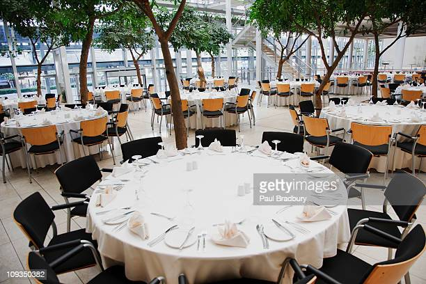 Empty chairs and tables set for luncheon