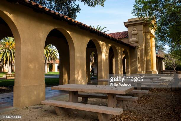 Empty chairs and tables sit outside the usually bustling student union during a quiet morning at Stanford University on March 9, 2020 in Stanford,...