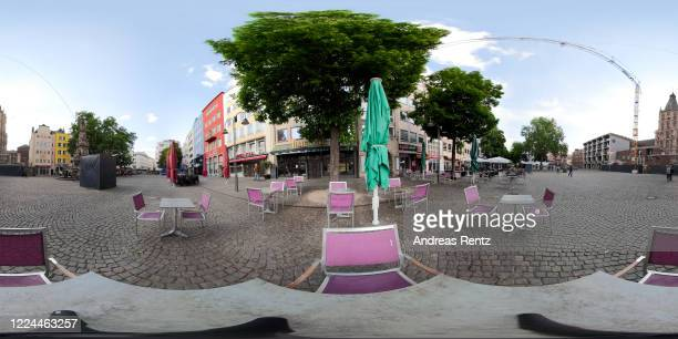 Empty chairs and tables with a social distance of 1.50 meters minimum to the next tables are seen at a cafe the day after restaurants and cafes were...