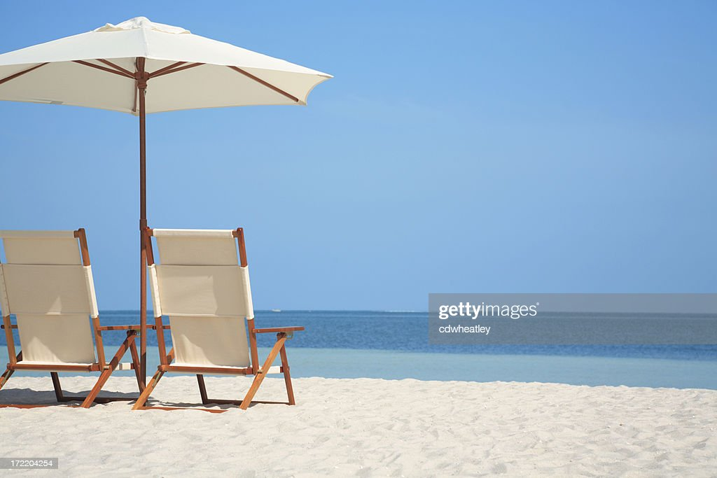 empty chairs and umbrella at a beach in Florida, USA : Stock Photo