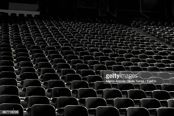 empty chairs at movie theater - auditorium stock pictures, royalty-free photos & images