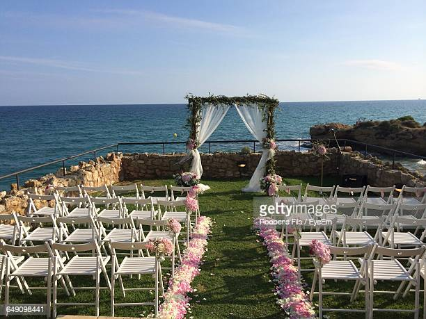 empty chairs at wedding ceremony - wedding ceremony stock photos and pictures