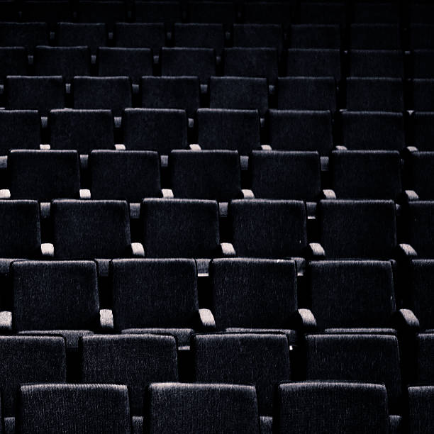 Empty Chairs in a Deserted Auditorium