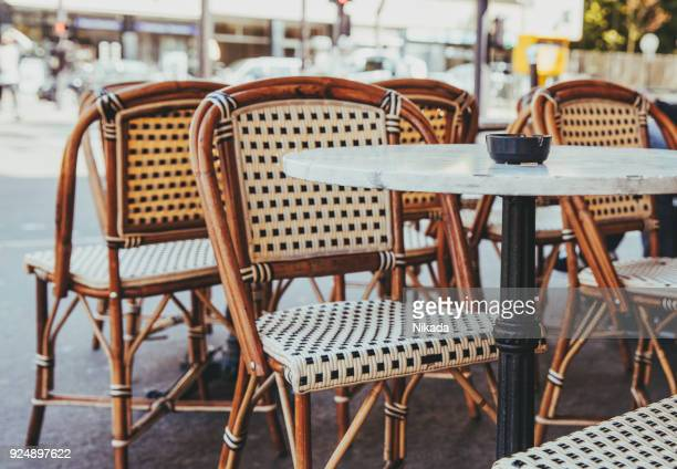empty chairs in a restaurant on the streets of paris - patio stock pictures, royalty-free photos & images