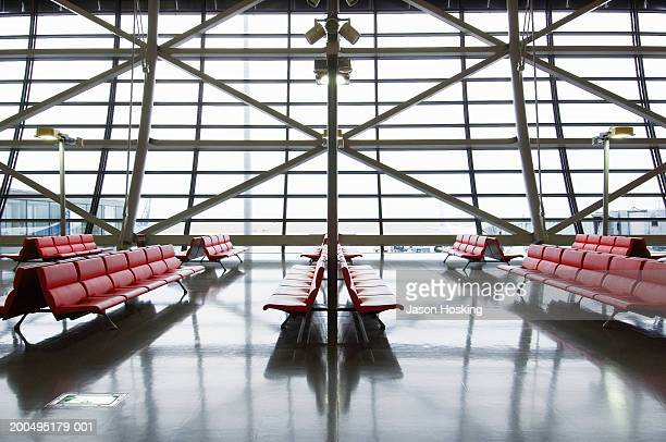 Empty chairs in airport departure gate area