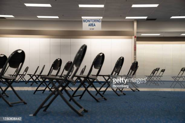 Empty chairs in an unused monitoring area for recipients of the Moderna Covid-19 vaccine at a mass vaccination super site operated by Sharp...
