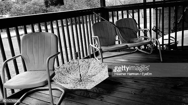 empty chairs in balcony of house - heather harmon stock pictures, royalty-free photos & images