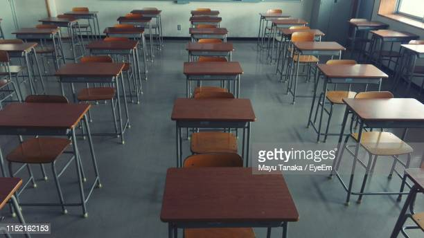 empty chairs in classroom at school - no people stock pictures, royalty-free photos & images