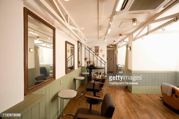 empty chairs in front of mirrors in hair cut shop at tokyo. - hair salon stock pictures, royalty-free photos & images