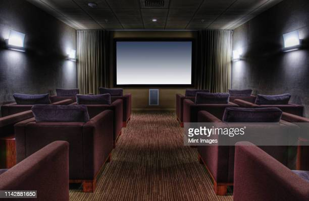 empty chairs in luxury movie theater - entertainment center stock pictures, royalty-free photos & images