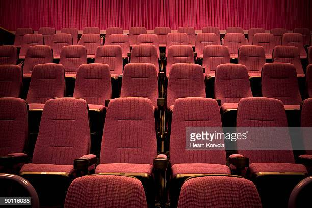 Empty chairs in movie theater.