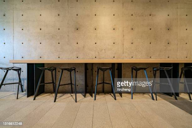 empty chairs in restaurant - metallic stock pictures, royalty-free photos & images