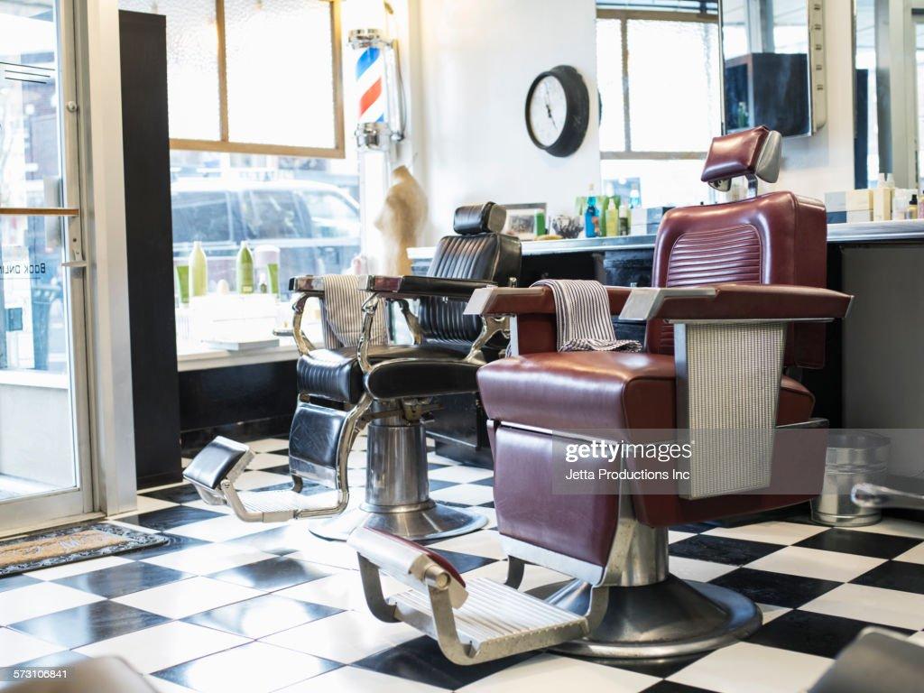 Empty chairs in retro barbershop : Stock Photo