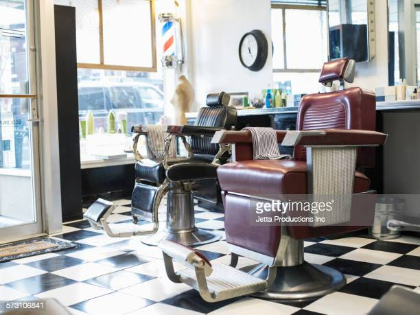 Empty chairs in retro barbershop