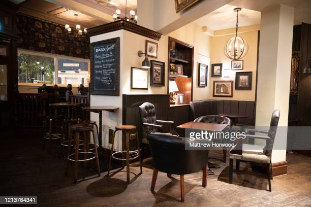 Empty chairs in the Duke of Wellington pub on March 20, 2020 in Cardiff, United Kingdom. This afternoon Boris Johnson announced that all pubs,...