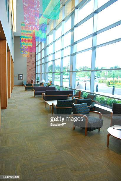 Empty chairs in waiting room with large windows
