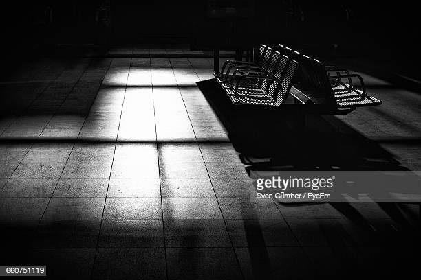 Empty Chairs On Tiled Floor In Waiting Room