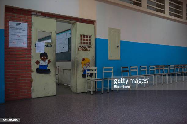 Empty chairs sit inside a polling station during a nationwide mayoral election in Caracas Venezuela on Sunday Dec 10 2017 Major opposition parties...