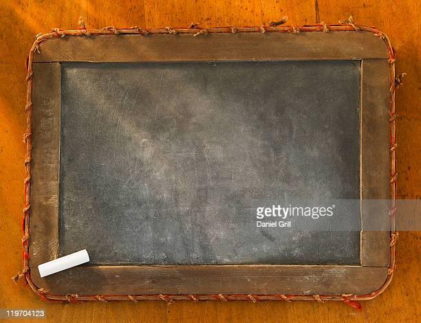 Empty chalkboard with chalk, studio shot