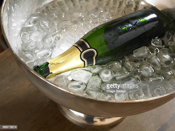 Empty champagne bottle in ice