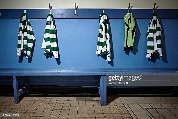 a empty changing room with football strips - locker room stock pictures, royalty-free photos & images