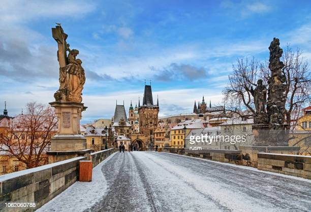 empty charles bridge at winter morning, prague - prague stock pictures, royalty-free photos & images