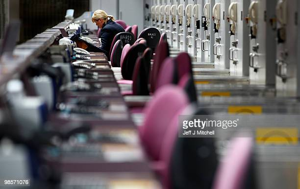 Empty check in desk at Glasgow Airport after closing a limited number of flights operated this morning on April 20 2010 in Glasgow Scotland Thousands...